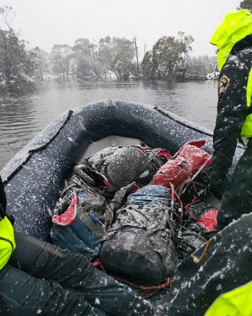 Search teams hunt for missing hiker Michael Bowman in dangerous Tasmanian weather conditions.