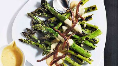 """Recipe: <a href=""""http://kitchen.nine.com.au/2016/05/16/14/32/grilled-asparagus-with-parmesan-cream-and-anchovies"""" target=""""_top"""">Grilled asparagus with parmesan cream and anchovies</a>"""