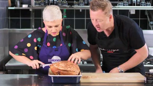 Chef Luke Mangan shows Jane de Graaff how to do the Christmas ham