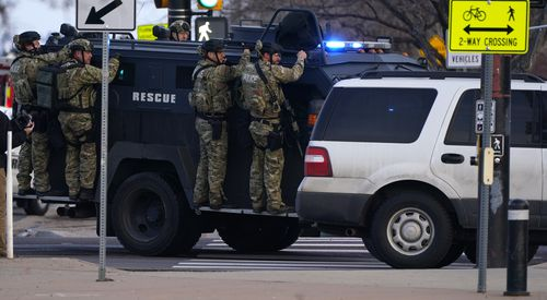 Police outside a King Soopers grocery store where a shooting took place Monday, March 22, 2021, in Boulder, Colo.