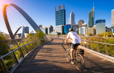 A man cycling on Elizabeth Bridge in Perth