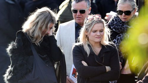 Mourners at Ms Dixon's funeral.