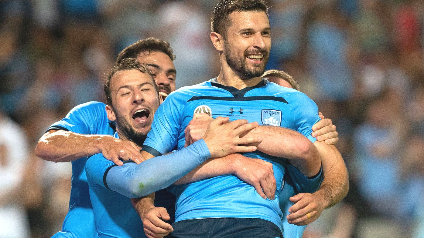 Kosta Barbarouses celebrated with Sydney FC teammates. (Getty)