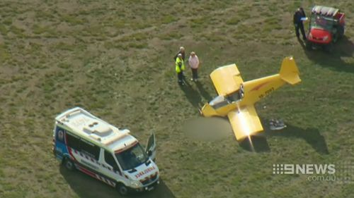 The pilot had died before rescuers were able to revive him. (9NEWS)