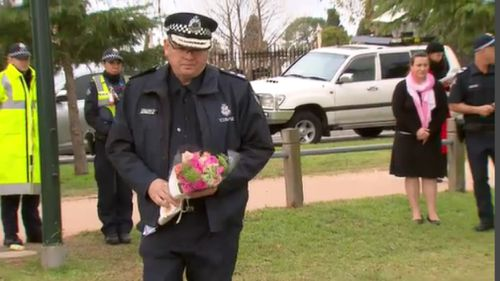 Chief Commissioner Graham Ashton has laid flowers at the memorial. (9NEWS)