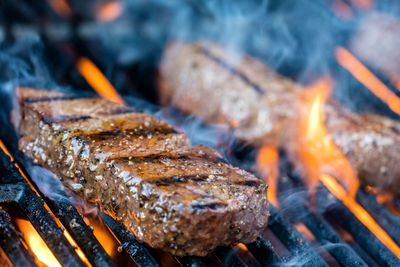 Steak: Grilling or pan frying with little to no added fat or oil
