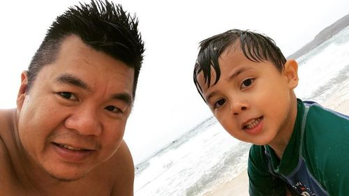 Alf Nguyen, pictured with his five-year-old son Chauncey.