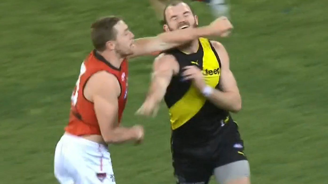 Essendon star Devon Smith in trouble over attempted punch at Kamdyn McIntosh