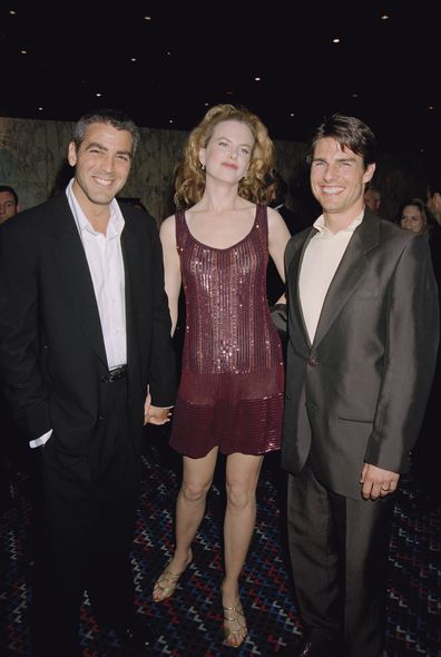 George Clooney poses with Tom Cruise and his wife Nicole Kidman in 1996.