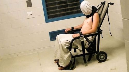 Dylan Voller is seen restrained, wearing a spit hood, in the Don Dale Youth Detention Centre. (Four Corners)