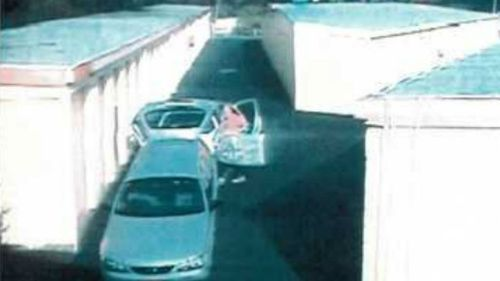 Footage of Glen McNamara carrying a silver surfboard bag toward a storage unit at Padstow in May 2014 was showed at the trial. (AAP)