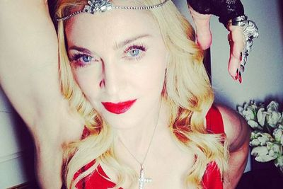 Madonna, Madonna, Madonna... must you wear 1,000 carats of diamonds to your manager's annual post-Oscars bash? <br/>