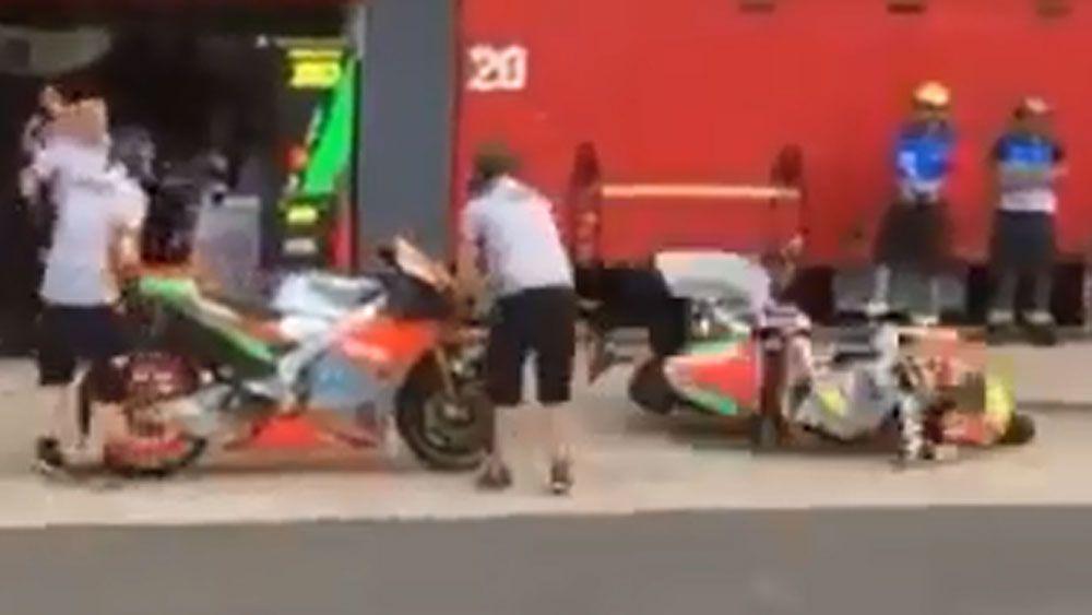 MotoGP rider flattens pit crew man