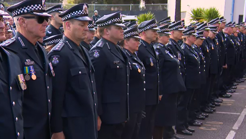 Colleagues, friends and family gathered at the St Kilda Police station grounds today.