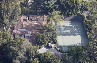 <b>Miley Cyrus</b> was only 18 when she bought herself a nice little pad to hang out it…paint her nails, chat on Facebook, you know, that kind of thing. But seriously, what can an 18 year old do with a whole <i>house</i>? The singer/actress' Spanish style, Los Angeles home cost $3.4 million…there's more zeroes in that than most teenagers could comprehend. But one thing's right with this purchase. It's just down the street from her parents home, so Miley can always run back to Mummy and Daddy when someone says something mean about her. The block is 4045 square feet with four bedrooms, 4.5 bathrooms, a recording studio and a detached guest house, tennis court and pool.