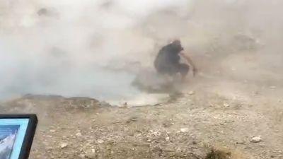 'Dumb' tourist jumps barricade to get closer look at geyser