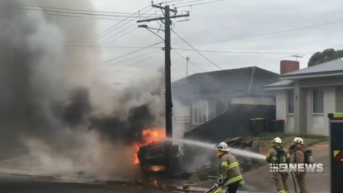 The burning car hit a power pole which had sparks flying from it as power was cut to hundreds of homes.