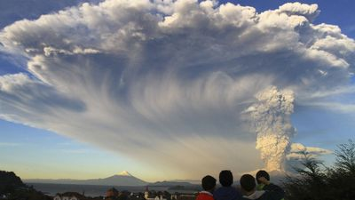 Children watch the Calbuco volcano erupt, from Puerto Varas, billowing a huge ash cloud over a sparsely populated, mountainous area in southern Chile. (AP/Carlos F. Gutierrez)