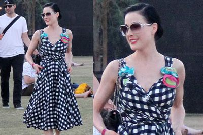 In a vintage gingham pattern dress, Dita dresses like she always does, and as always, the look is babin'.<br/><br/><i>Dita Von Teese at Coachella Festival 2012<br/>Image: Snappermedia</i>