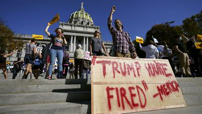 People celebrate outside the Pennsylvania State Capitol, Saturday, Nov. 7, 2020, in Harrisburg, Pa., after Democrat Joe Biden defeated President Donald Trump to become 46th president of the United States.