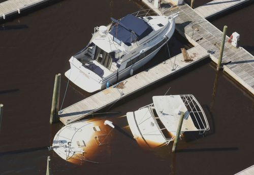 Boats are sunk and aground at Carolina Beach after the hurricane swept through.