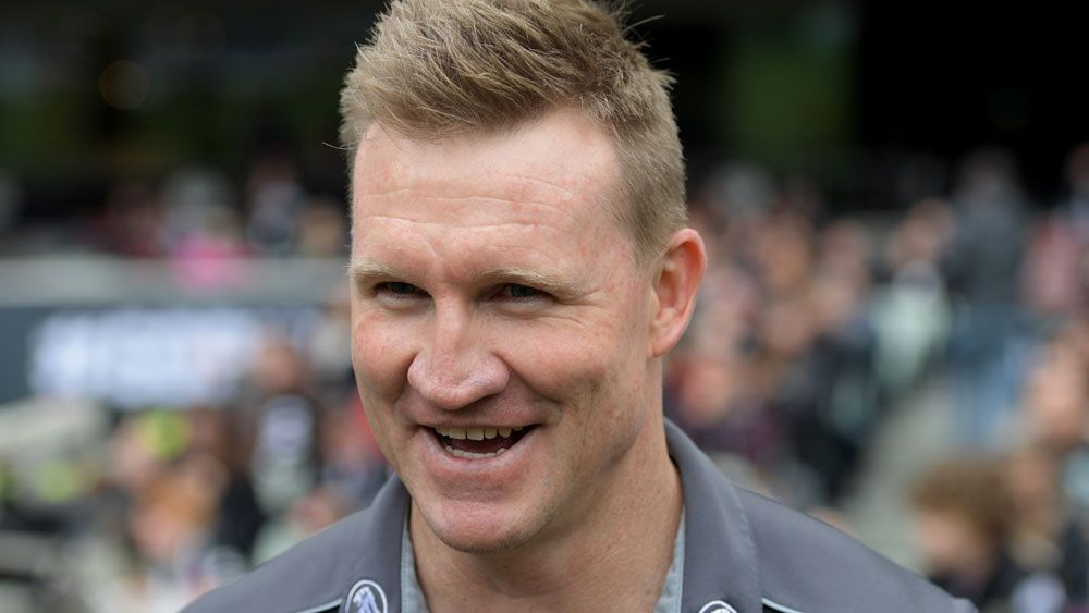 Collingwood Magpies re-appoint coach Nathan Buckley for another two years