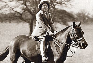 Elizabeth II as a child riding horse (Getty)