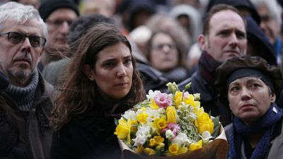 Thousands have turned out to pay their respects to the five victims of last week's attack on France's Charlie Hebdo magazine, including two cartoonists. (AFP)