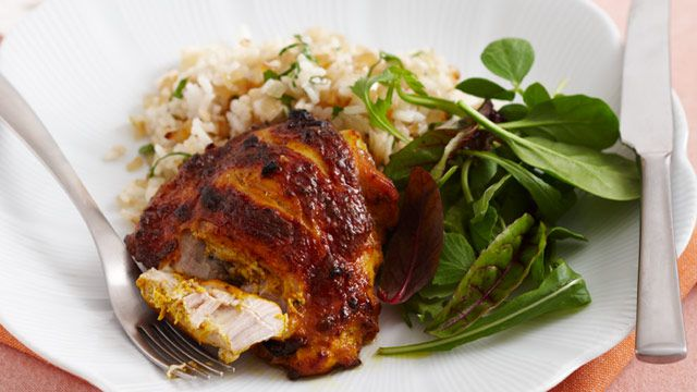 Spicy chicken with fried parsley rice