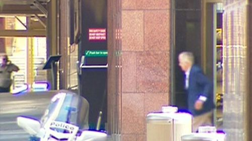 The first hostage exits the cafe at Martin Place. (Seven Network)