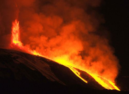 A spectacular night-time photo of Mount Etna exploding last year.