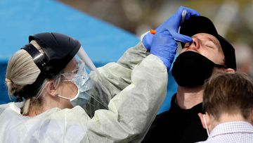A man being tested for coronavirus in New Zealand.