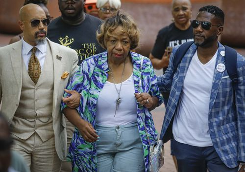 Reverend Kirsten Foy (left), president of Arc of Justice, and New York City Public Advocate Jumaane Williams (right) escort Gwen Carr, mother of chokehold victim Eric Garner, to a news conference outside New York Police Department headquarters, after NYPD Commissioner James O'Neill announced his decision to fire Officer Daniel Pantaleo for the 2014 death of Garner.