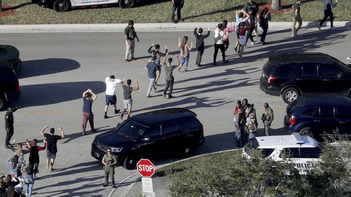 Students are led away from Marjory Stoneman Douglas High School in the aftermath of the shooting.