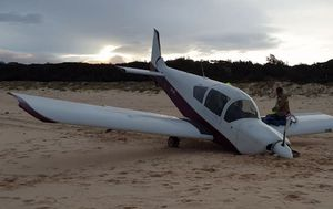 Small plane crashes onto NSW beach in front of shocked onlookers