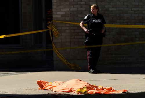 Bodies were covered in orange blankets waiting to be examined by the coroner.