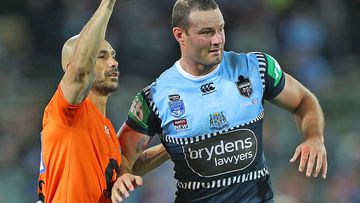 Boyd Cordner of the Blues is assisted by a trainer after a head knock