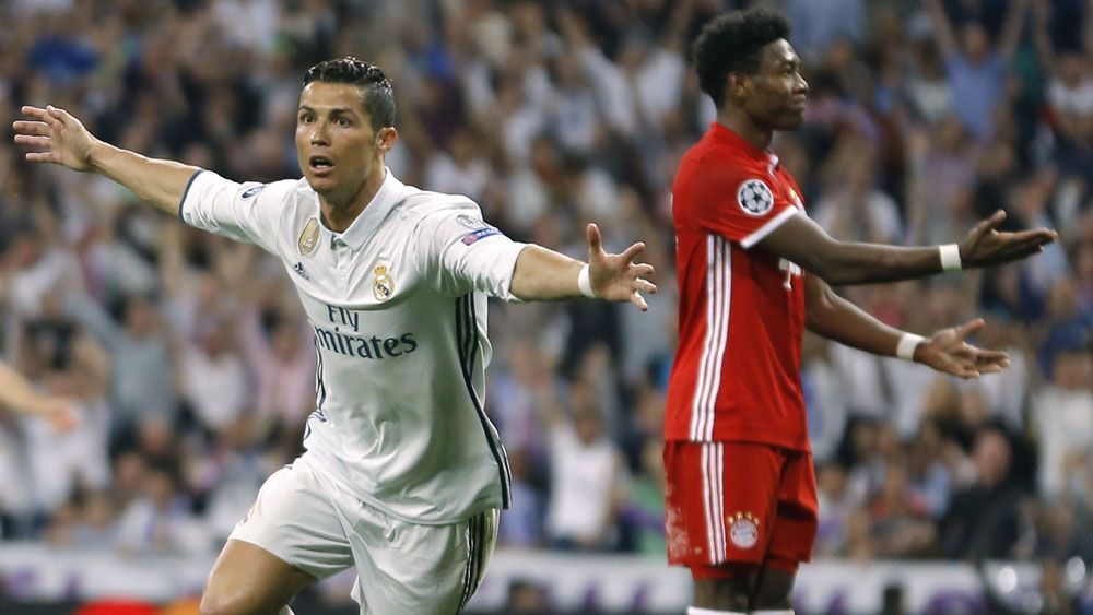 Cristiano Ronaldo hat-trick gets Real Madrid through in European Champions League