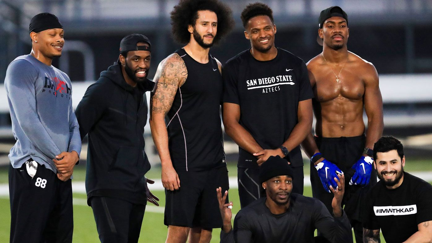 Colin Kaepernick stands with Bruce Ellington, Brice Butler, Jordan Veasy, and Ari Werts during the NFL workout