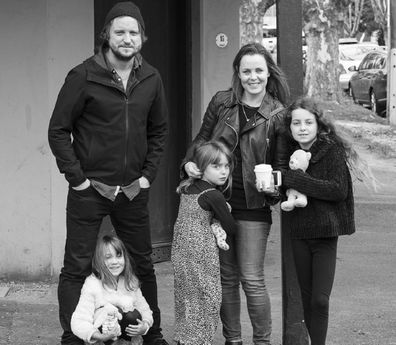 Daniel Lewis with his partner and three daughters