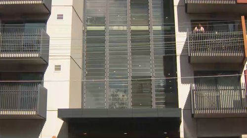 Residents in this apartment block in Camperdown are locked down for two weeks after four people tested positive to coronavirus.