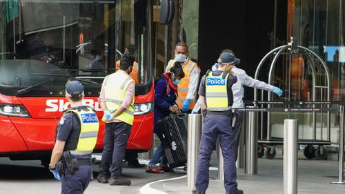 Overseas travellers arrive at Crown for quarantine.