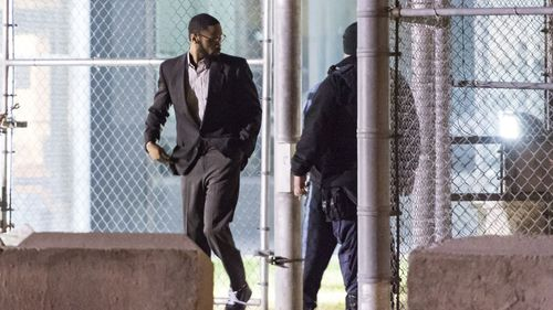 McCoy, seen here walking free from jail, is now back behind bars in Hawaii accused of human trafficking.