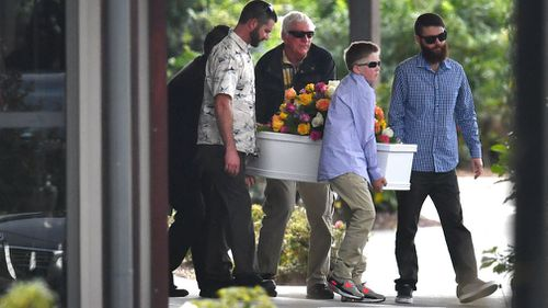 A small white coffin is carried from the chapel. Picture: AAP