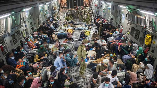 Australian citizens and Afghan visa holders aboard a C-17A Globemaster III leaving Kabul.