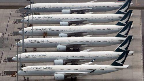 Cathay Pacific planes lay idle on the tarmac at Hong Kong Airport.