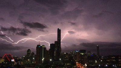 Lightning and the neon lights of the Brisbane CBD. (Twitter @AlleMcMahon)