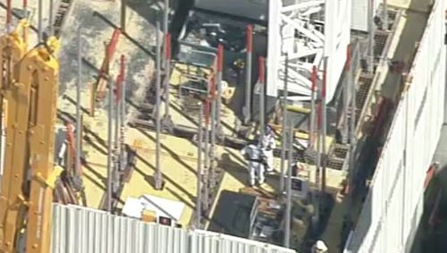 A man has died after falling off a crane in North Sydney. (9NEWS)