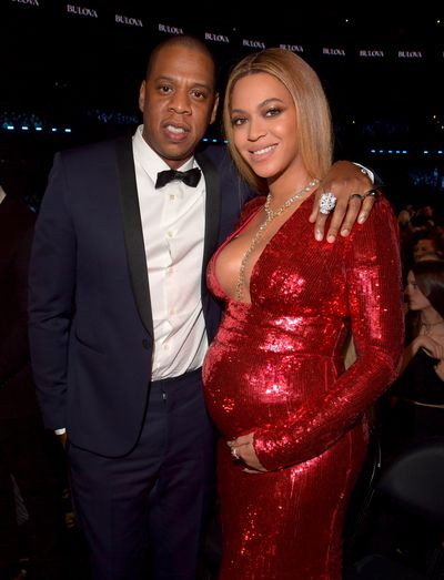 Jay-Z and Beyonce in a glittering red gown by Peter Dundas at the 2017 Grammy Awards