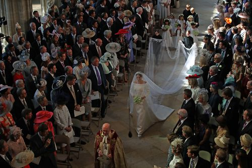 Meghan cut a glamorous figre as she walked through the chapel. (AAP)